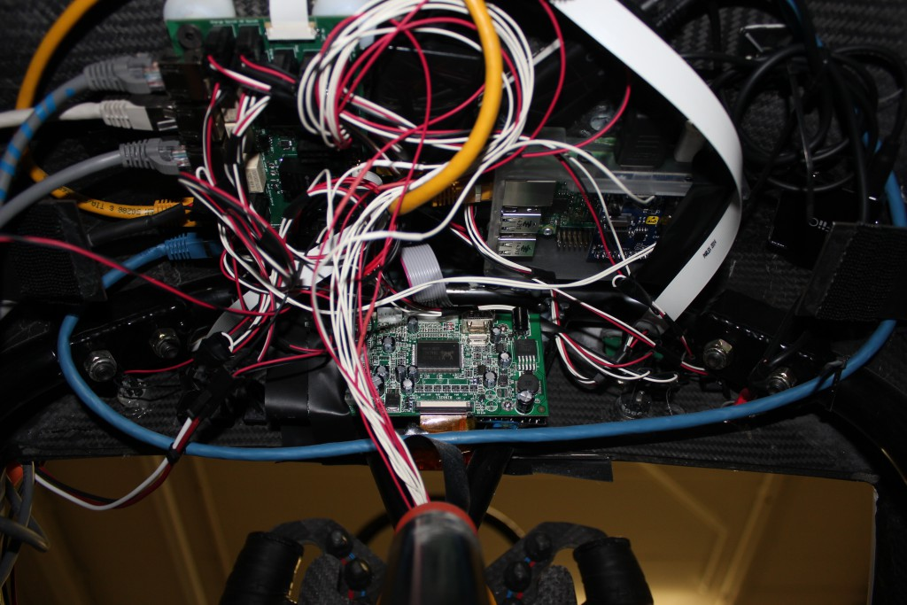 The Raspberry Pi 2 sits behind the dashboard (that's the wheel at the bottom!) and powers the display. When the car is racing, it automatically sends telemetric data to the team in the pits