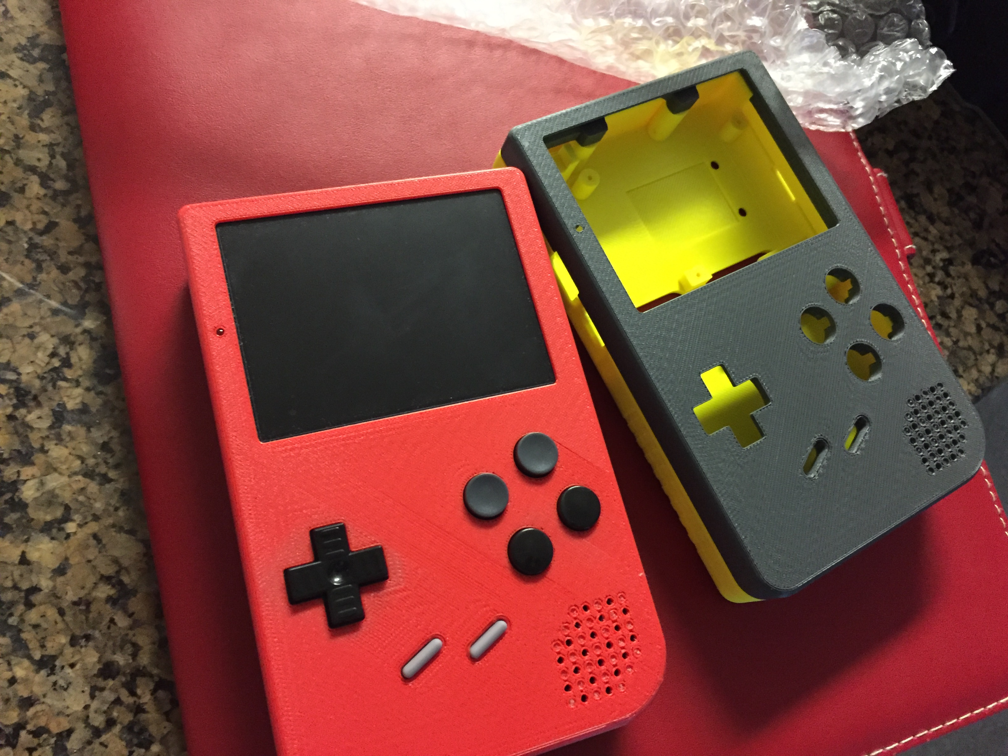 An early prototype next to the final versions