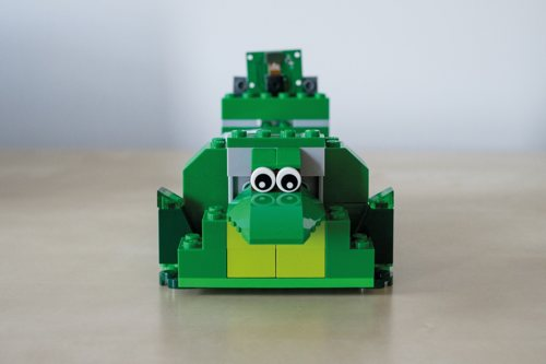 The cute croc-shaped case is built from his son's green LEGO bricks