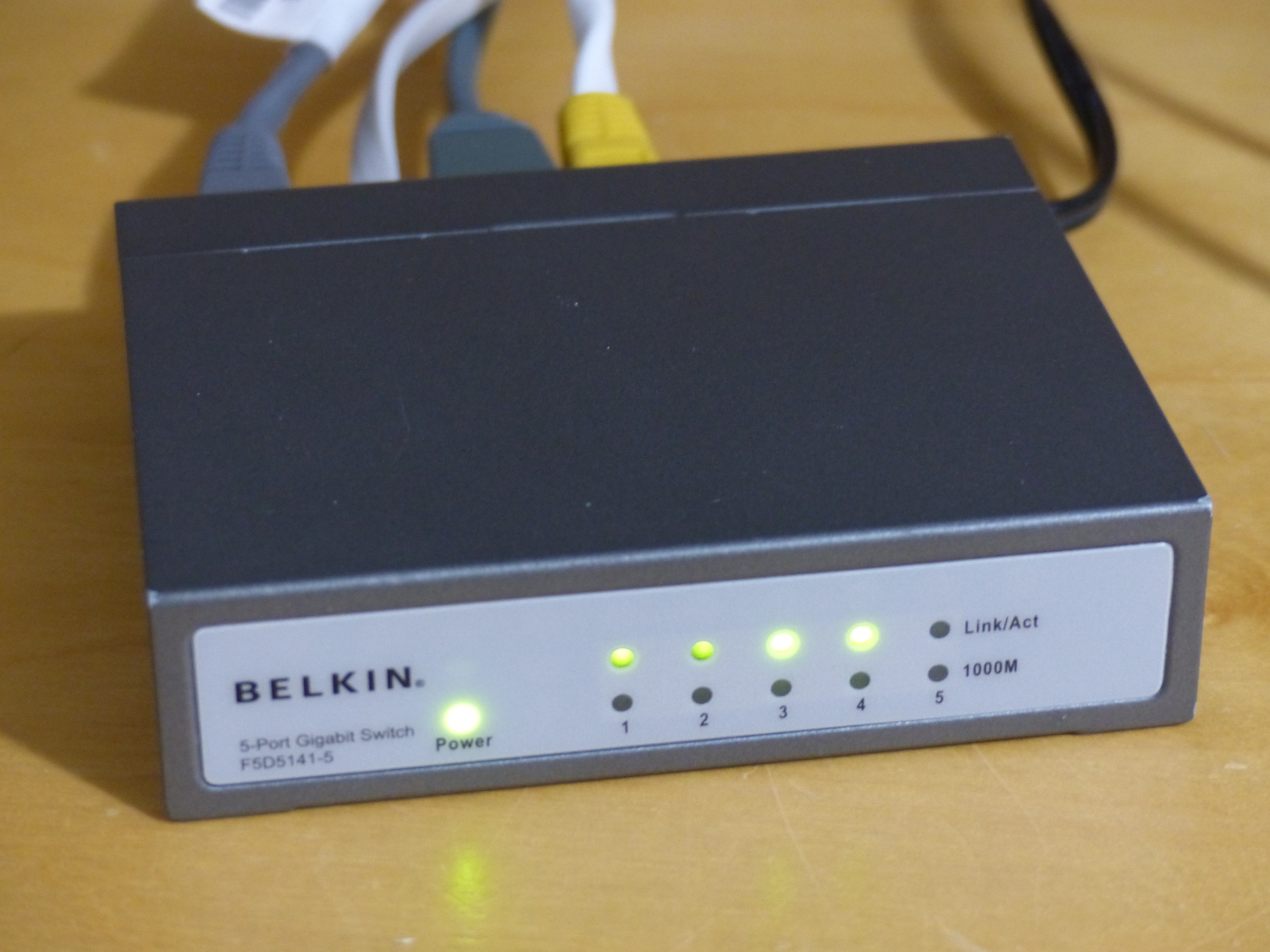 You'll need an Ethernet switch – if you run out of ports, most VoIP phones have a pass-through connector to chain other devices