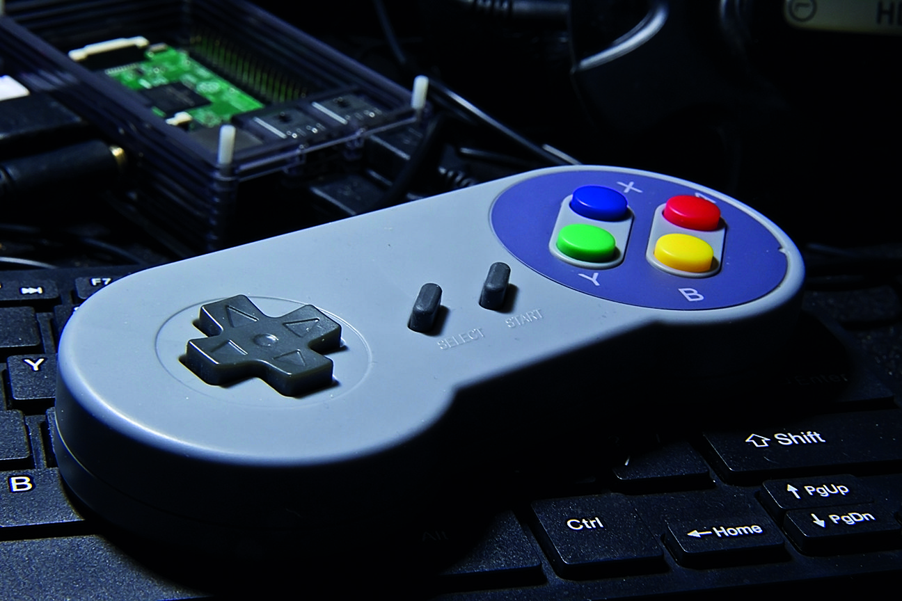 You can plug a gamepad or joystick into one of the USB ports on your Raspberry Pi