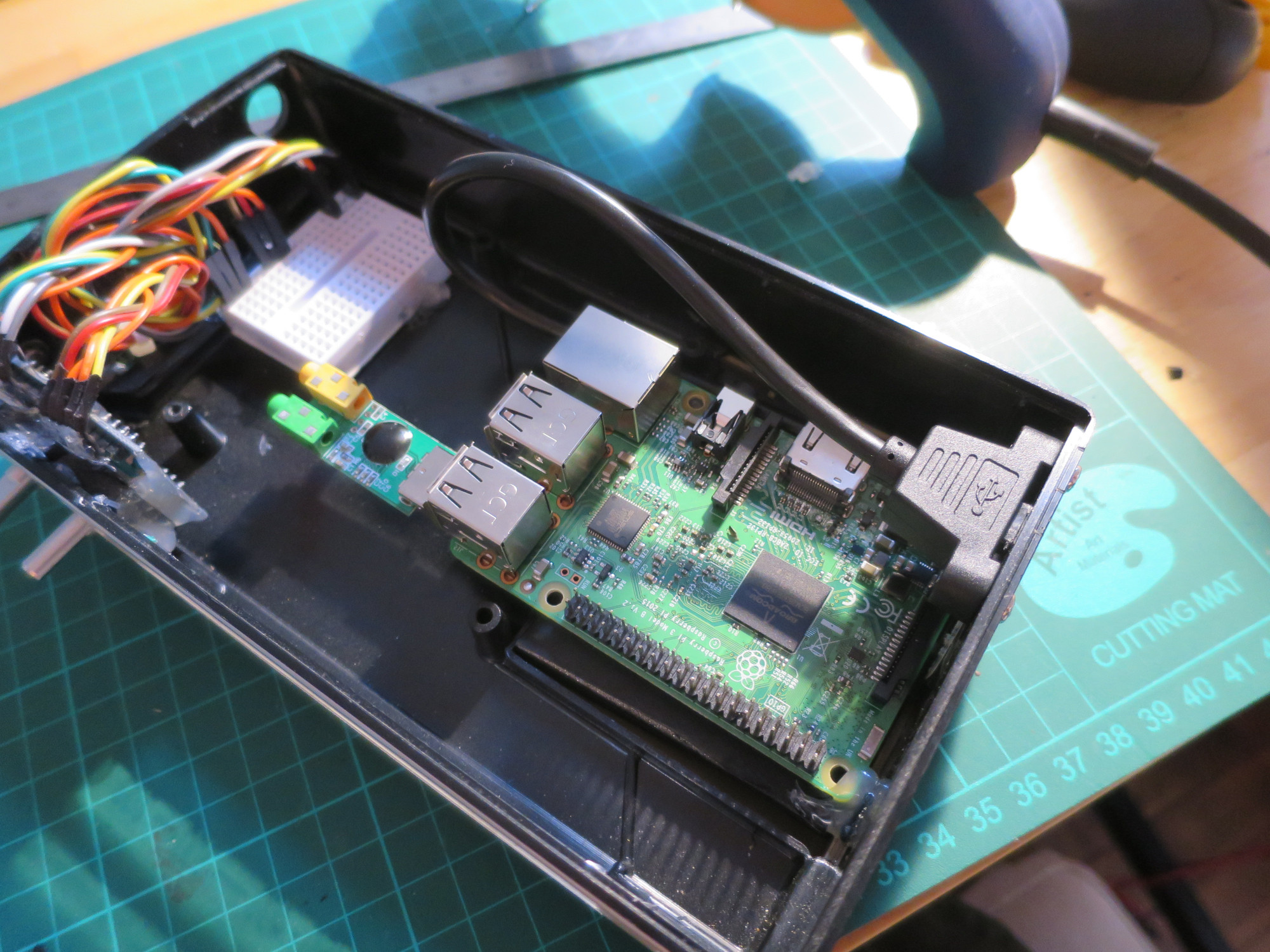 With the speaker removed, we can see an elegant power solution which offers more flexibility over the Pi's location