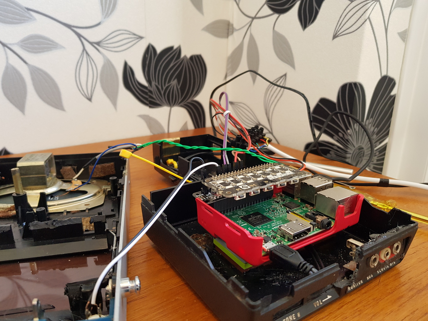 Raspberry Pi and pHAT BEAT are placed inside an old cassette player wired to the intercom outside. The pHAT BEAT is also connected to the player's original speaker so that speech and the chime can be heard