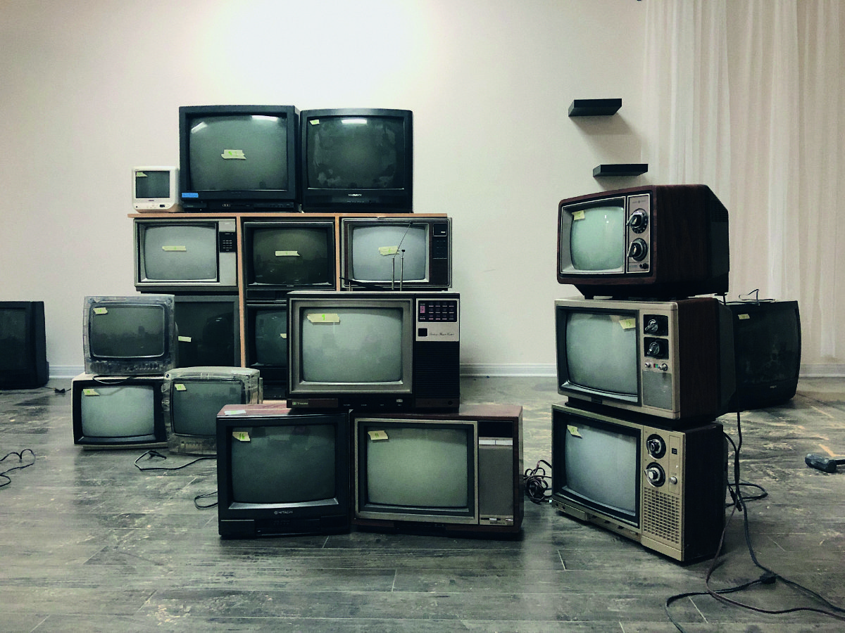 A TCP Syphon Server application connects to the TV Wall network, enabling the video or visual output generated by the VJ software to be displayed in real‑time on the wall