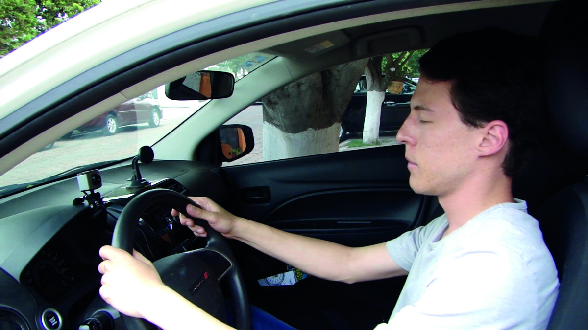 Andre tests out the system by closing his eyes – note that for safety reasons, he's parked in his driveway!